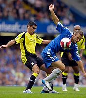 Photo: Daniel Hambury.<br />Chelsea v Manchester City. The Barclays Premiership. 20/08/2006.<br />Chelsea's Andriy Shevchenko and City's Claudio Reyna battle.