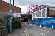 Blue hoarding near the refurbishment of the iconic Selfridges building in the city centre on 3rd August 2021 in Birmingham, United Kingdom. The exterior of the building has been wrapped in scaffolding and a pink protective covering while it undergoes renovation while the discs are cleaned and repainted in its original colour.