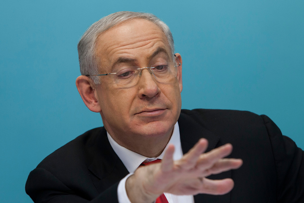 Israel's Prime Minister Benjamin Netanyahu is seen during a press conference in which the Israeli government presented a new planned sea ports reform in Israel, at the Prime Minister's Office in Jerusalem, on July 3, 2013. The Israeli government initiated a tender for two new private ports to operate beside existing government-owned ports in Haifa and Ashdod in a bid to raise competition, break the monopoly in the current system and lower the costs of good in Israel.