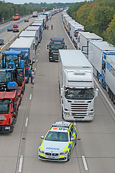 ©Licensed to London News Pictures 16/09/2020  <br /> Ashford, UK. The front of the queue of hundreds of lorries being held by police just before junction 9 on the M20.  There is freight chaos on the roads in Kent this afternoon as Operation Stack is implemented due to increased security checks at the Port of Dover and Eurotunnel. The M20 motorway is closed to cars between junction eight and nine so police can hold freight traffic. Photo credit:Grant Falvey/LNP