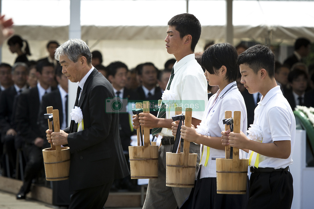 August 9, 2016 - Nagasaki, Nagasaki Prefecture, Japan - NAGASAKI, JAPAN - AUGUST 9 : Representatives of bereaved families and youth representatives offer water for the atomic bomb victims in front of the Peace Statue in Nagasaki Peace Park, Nagasaki, southern Japan, Tuesday, August 9, 2016. Japan marked the 71st anniversary of the atomic bombing on Nagasaki. On August 9, 1945, during World War II, the United States dropped the second Atomic bomb on Nagasaki city, killing an estimated 40,000 people which ended World War II. (Credit Image: © Richard Atrero De Guzman/NurPhoto via ZUMA Press)
