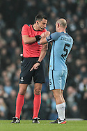 Bizarre moment as Slavko Vinčić (Referee) gets Pablo Zabaleta's (Manchester City) help to fix his radio during the Champions League match between Manchester City and Celtic at the Etihad Stadium, Manchester, England on 6 December 2016. Photo by Mark P Doherty.