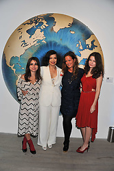 Left to right, ASSISI JACKSON, BIANCA JAGGER, JADE JAGGER and AMBA JACKSON at Arts for Human Rights gala dinner in aid of The Bianca Jagger Human Rights Foundation in association with Swarovski held at Phillips de Pury & Company, Howick Place, London on 13th October 2011.