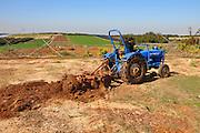 Israel, farmer ploughs field