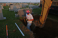 Rainsville, Alabama: Blake Chandler, 19, finishes digging a grave--his eighth in two days--for a resident who died in the tornados that blasted through this rural northeastern Alabama town. Officials have confirmed that 33 people died in Rainsville and surrounding DeKalb County. (PHOTO: MIGUEL JUAREZ LUGO)