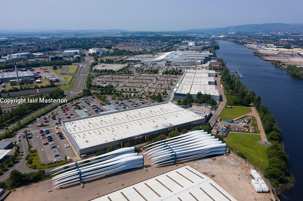 Aerial view of Braehead shopping and retail park next to River Clyde and wind turbine blades at King George V dock in Glasgow, Scotland, Uk