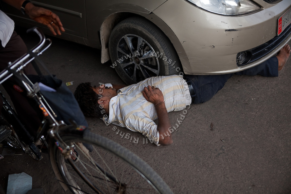 A man lying, supposedly drunk, in the middle of a congested junction is struggling under an incoming car. The car moved back and drove away. The Taj Mahal has been struggling to keep in shape also because of the high levels of pollution in the city, mainly caused by congested roads and high levels of traffic, vehicles and an increasing population, in Agra.