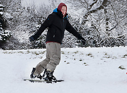 © Licensed to London News Pictures. 01/02/2019. High Wycombe, UK. A snow boarder enjoys the wintry conditions in High Wycombe, Buckinghamshire after overnight snow falls and continuing low temperatures. Photo credit: Peter Macdiarmid/LNP