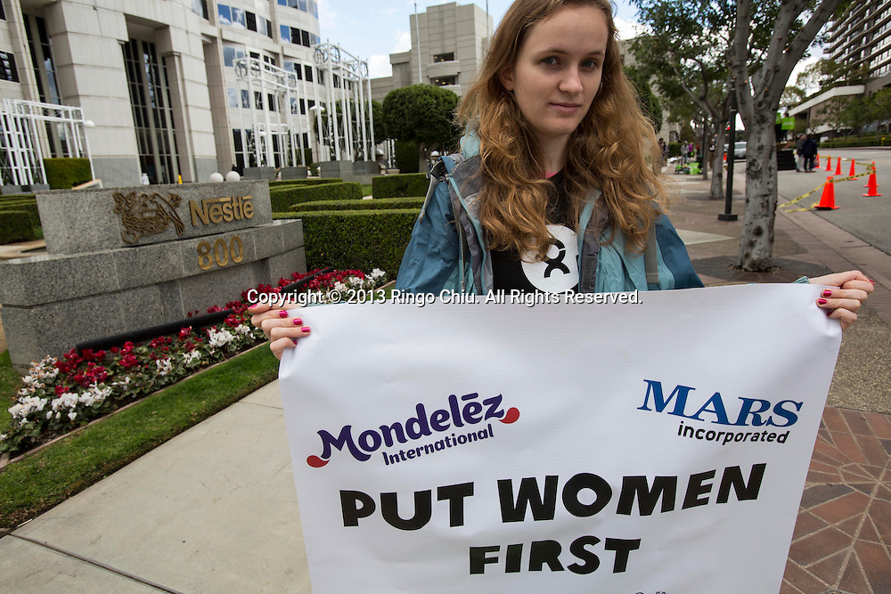 A member of Oxfam America, a relief and development organization, protests at Nestle's headquarters in Burbank to urge the company to address poor conditions for women in their supply chains, on International Women's Day, March 8, 2013 in Los Angeles, California. (Photo by Ringo Chiu/PHOTOFORMULA.com).