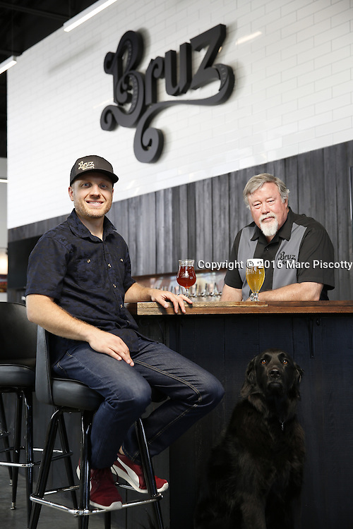 SHOT 7/22/16 1:45:40 PM - Bruz Beers co-founders Charlie Gottenkieny and Ryan Evans inside the new brewery near 67th Avenue and Pecos in Denver, Co. Bruz Beers is Denver's artisanal Belgian-style brewery, featuring a full line of traditional and Belgian-inspired brews, hand-crafted in small batches. Includes images of Evan's dog 'Cooper' as well who serves as the brewery dog. (Photo by Marc Piscotty / © 2016)