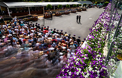 Spectators are led into the grounds at the start of day seven of the Wimbledon Championships at the All England Lawn Tennis and Croquet Club, Wimbledon.