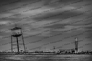 Around 1980, Ralph Britten purchased this water tower from Lefors, Texas and brought it to the town of Groom.  Intentionally set to lean at 80 degrees, it was done as a good old fashioned American marketing ploy.  It worked, too, bringing in business for Britten's Truck Stop & Resaurant, until an electrical fire put an end to the business.  Motorists still pull off the freeway and take their pictures as they did when the truck stop was open.  Americana at its finest!