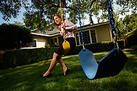 Menlo Park, CA -- Susan Wojcicki, Google Vice President of Product Management, responsible for the product management of AdSense as well as Google Book Search, Google Video and the syndication of Google products to partners worldwide poses at her former home in Menlo Park.  In 1998, Susan's Menlo Park garage served as Google's first headquarters for Google company founders Larry Page and Sergey Brin who sublet the garage. When she joined the young company in 1999, Susan was the small staff's first marketing professional.   Photo by Jack Gruber, USA TODAY