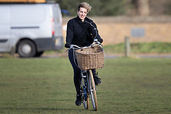 © Licensed to London News Pictures. 11/03/2021. London, UK. A woman cycles on a windy Blackheath Common in South East London. A yellow weather warning for wind is in place in parts of the UK. Photo credit: George Cracknell Wright/LNP