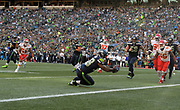 Aug 25, 2017; Seattle, WA, USA; Seattle Seahawks running back Tre Madden (38) scores on a 2-yard touchdown reception in the second quarter against the Kansas City Chiefs during a NFL football game at CenturyLink Field.