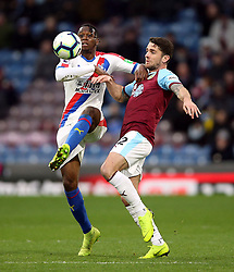 Burnley's Robbie Brady (right) and Crystal Palace's Aaron Wan-Bissaka battle for the ball during the Premier League match at Turf Moor, Burnley.