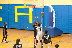 "Jahquan Gumbs goes for the shot.  Milton M. Newton Summer Classic featuring ""Jah Youths"" versus  the ""Legends"".  Charlottel Amalie High School.  St. Thomas, USVI.  10 August 2016  © Aisha-Zakiya Boyd"
