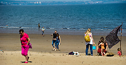 Pictured: <br /> Portobello Beach was the main attraction in Edinburgh today as the sun made an appearance after a number of dull wet days.<br /> <br /> <br /> Ger Harley | EEm 12 July 2017