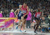 Athletics - 2017 IAAF London World Athletics Championships - Day Five, Evening Session<br /> <br /> Mens 3000m Steeplechase Final<br /> <br /> Conseslus Kipruto (Kenya) comes out of the water hurdle along with Soufiane ElBakkali (Morocco) and goes on to win gold<br /> <br /> at the London Stadium<br /> <br /> COLORSPORT/DANIEL BEARHAM