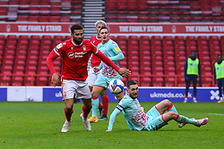 Matt Grimes of Swansea City watches the ball, as Cyrus Christie of Nottingham Forest chases - Mandatory by-line: Nick Browning/JMP - 29/11/2020 - FOOTBALL - The City Ground - Nottingham, England - Nottingham Forest v Swansea City - Sky Bet Championship