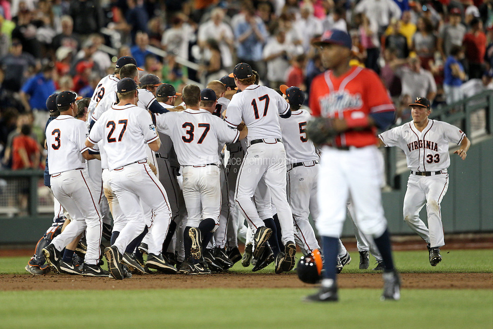 Mike Papi #38 of the Virginia Cavaliers celebrates his walk-off hit with teammates during Game 4 of the 2014 Men's College World Series between the Virginia Cavaliers and Ole Miss Rebels at TD Ameritrade Park on June 15, 2014 in Omaha, Nebraska. (Brace Hemmelgarn)