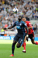 Newcastle's Moussa Sissoko makes a break. Barclays Premier League match, Cardiff city v Newcastle Utd  at the Cardiff city stadium in Cardiff, South Wales on Saturday 5th Oct 2013. pic by Andrew Orchard, Andrew Orchard sports photography,
