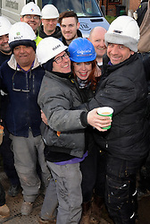 © Licensed to London News Pictures. 12/03/2013.The BBC's DIYSOS team are in Orpington, Kent this week till the (21.03.2013). Nick Knowles and the team of builders  which includes local tradesmen arrived on the (12.03.2013) to help build a family in need a new home..ltr.Billy Byrne - Electrician.Mark Millar - Builder.Gabrielle Blackman - Designer.Nick Knowles-Presenter.Photo credit : Grant Falvey/LNP