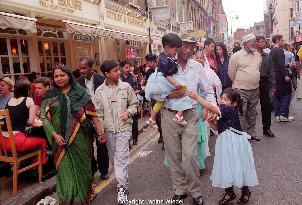 Bangladeshi family on Brick Lane East  London.