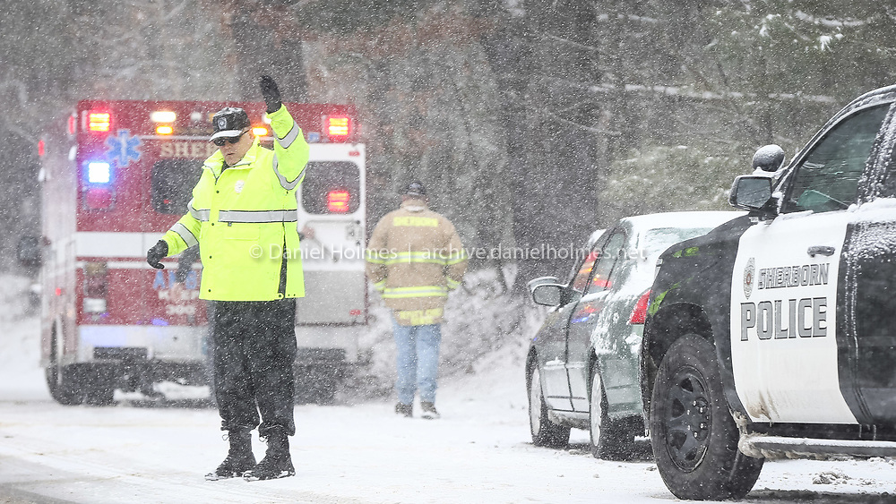 (4/4/16, SHERBORN, MA) Sherborn Lt. David Bento directs traffic at a crash involving 3 vehicles near 260 Washington St. (on the Holliston line) in Sherborn Monday afternoon. One person was transported to the hospital with non-life-threatening injures. Daily News and Wicked Local Photo/Dan Holmes