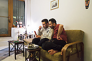 Istanbul, Turkey. At home, partners Nader (right) and Omar (left) talk to Omar's mother on the eve of Nader's departure to Norway where he has been granted political asylum. the couple share an apartment in central Istanbul.