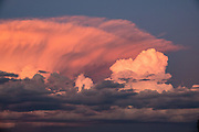Sunset illuminates thunderheads seen from San Carlos de Bariloche (Bariloche for short), a resort town in Nahuel Huapi National Park, Río Negro Province, Argentina, Andes foothills, South America.