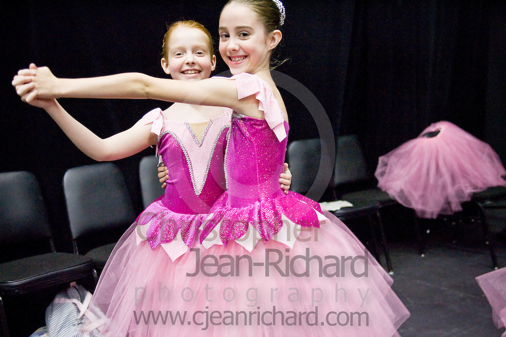 Two young ballerinas from the Tulsa Ballet Centre for Dance Education's Open Division, backstage before performing at the VanTrease Performing Arts Center of  Tulsa Community College...Tulsa, Oklahoma; May 2008.