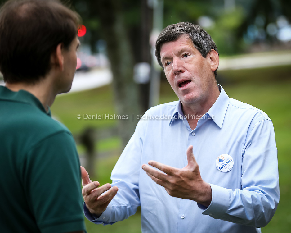 (7/27/14, ASHLAND, MA) Candidate for congress Dr. Sheldon Schwartz speaks to a voter at the Ashland Democratic Town Committee's summer social at Stone Park in Ashland on Sunday. Daily News and Wicked Local Photo/Dan Holmes