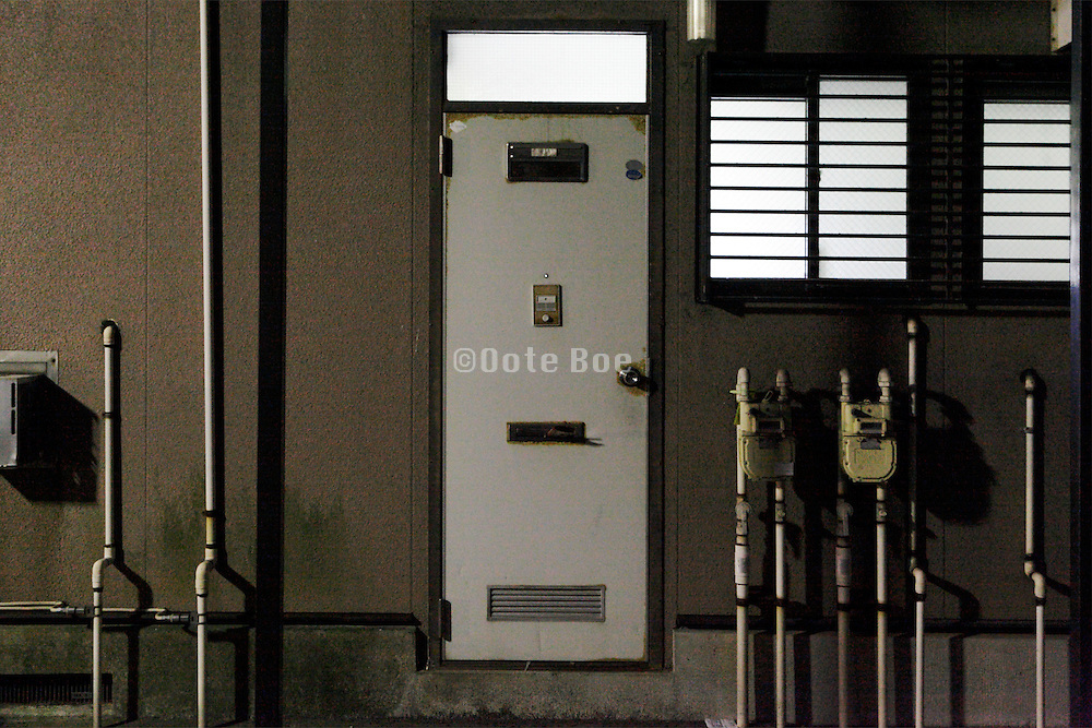 front door of an old style small residential apartment Japan Yokosuka