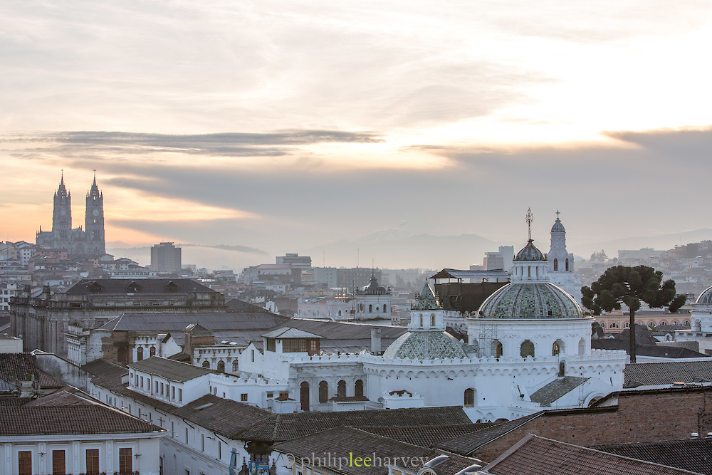 Quito skyline showing The Basilica of the National Vow and Church of the Company on the right, Ecuador, South America