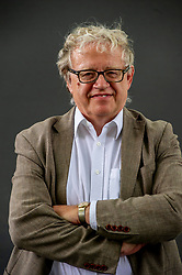 Pictured: Keith Hartley<br /><br />Keith Hartley is Chief Curator and Deputy Director of Modern and Contemporary Art at the National Galleries of Scotland.  His book, Andy Warhol & Eduardo Paolozzi – I Want to Be a Machine, offers a compare-and-contrast examination of two very different artists with much in common.  Illustrating their fascination with popular culture, it was only in the 1960s that the artists made the step to mechanical means to create their own artworks, resulting in the iconic images that are integral to our culture. As Warhol said of himself, there is only surface, with nothing underneath.<br /><br />Ger Harley   EEm 24 August 2019