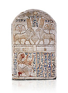 """Ancient Egyptian stele odedicated to Amon Re the """"good Ram"""" by foreman Baki, limestone, New Kingdom, 19th Dynasty, (1290-1213 BC), Deir el-Medina, Drovetti cat 1549. Egyptian Museum, Turin. white background,. Reign of Ramesses II.<br /> <br /> This round-topped stele is carved in low relief and painted <br /> in several colours. The pictorial plane is divided into two <br /> registers, the upper one containing two rams facing each <br /> other. The animals, with cobras rising on their foreheads, <br /> wear tall headdresses composed of two tall plumes with a <br /> solar disk at the centre. Between them is a small offering <br /> table with lotus flowers. The mirror image hieroglyphic <br /> inscription refers to the rams and reveals their divine <br /> nature as that of Amun-Ra. In the register below, <br /> foreman Baki is shown in the pose of adoration. .<br /> <br /> If you prefer to buy from our ALAMY PHOTO LIBRARY  Collection visit : https://www.alamy.com/portfolio/paul-williams-funkystock/ancient-egyptian-art-artefacts.html  . Type -   Turin   - into the LOWER SEARCH WITHIN GALLERY box. Refine search by adding background colour, subject etc<br /> <br /> Visit our ANCIENT WORLD PHOTO COLLECTIONS for more photos to download or buy as wall art prints https://funkystock.photoshelter.com/gallery-collection/Ancient-World-Art-Antiquities-Historic-Sites-Pictures-Images-of/C00006u26yqSkDOM"""