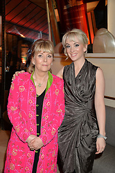 Left to right, KATE ATKINSON winner of the Costa Novel Award and her daughter HELEN ATKINSON at the Costa Book Awards 2013 held at Quaglino's, 16 Bury Street, London on 28th January 2014.