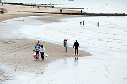 Families play on Cleethorpes beach. Cleethorpes is situated on Englands East Coast on the river Humber's tidal estuary. ..1 July 2012.Image © Paul David Drabble