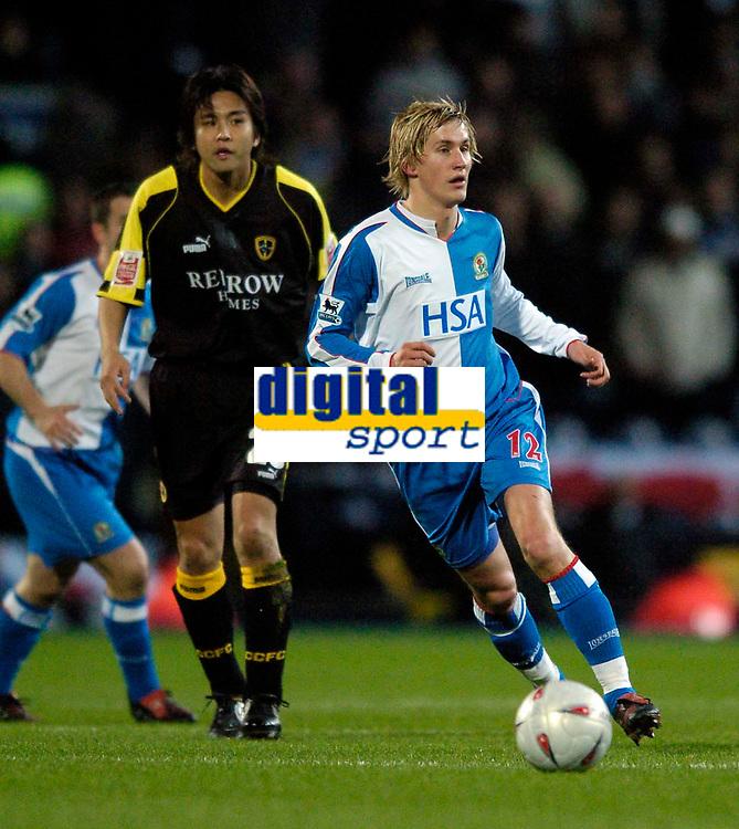 Fotball<br /> England 2004/22005<br /> Foto: SBI/Digitalsport<br /> NORWAY ONLY<br /> <br /> Blackburn v Cardiff<br /> FA Cup 3rd Round Replay, 19/01/2005.<br /> <br /> Blackburn's Morten Gamst Pedersen (R) with Cardiff's Junichi Inamoto