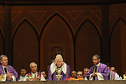 Chicago Archbishop Francis Cardinal George (center) prepares communion during a mass at Holy Name Cathedral to promote service in the church for high school students from the Chicago Archdiocese and the diocese of Rockford and Joliet.