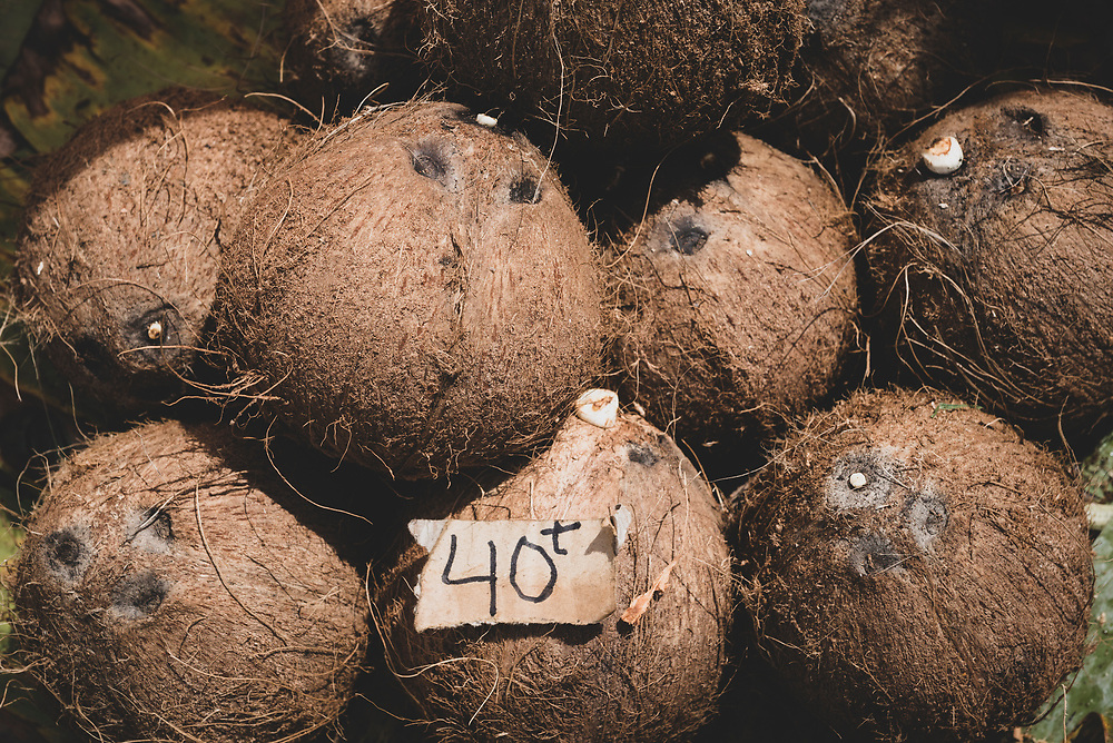Husked brown coconuts displayed for sale at the market in Wewak, Papua New Guinea. The cost is 40 toea per coconut.<br /><br />(July 21, 2017)
