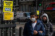 People out for their daily exercise pass Messages  of support for the 'awesome' NHS are posted on lamposts near Parliament, which remains closed. The 'lockdown' continues in London because of the Coronavirus (Covid 19) outbreak.