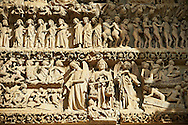 Tympanum of central west portal: Scenes from the Last Day of Judgement. Gothic Cathedral of Notre-Dame, Amiens, France . The Cathedral Basilica of Our Lady of Amiens or simply Amiens Cathedral, is a Roman Catholic  cathedral the seat of the Bishop of Amiens. It is situated on a slight ridge overlooking the River Somme in Amiens. Amiens Cathedral, was built almost entirely between 1220 and c.1270, a remarkably short period of time for a Gothic cathedral, giving it an unusual unity of style. Amiens is a classic example of the High Gothic style of Gothic architecture. It also has some features of the later Rayonnant style in the enlarged high windows of the choir, added in the mid-1250s. Amiens Cathedra has been listed as a UNESCO World Heritage Site since 1981. Photos can be downloaded as Royalty Free photos or bought as photo art prints. <br /> <br /> Visit our MEDIEVAL PHOTO COLLECTIONS for more   photos  to download or buy as prints https://funkystock.photoshelter.com/gallery-collection/Medieval-Middle-Ages-Historic-Places-Arcaeological-Sites-Pictures-Images-of/C0000B5ZA54_WD0s