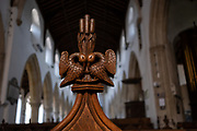 Intricate wooden carvings on the end of pews in the Church of St. Michael's, on 10th August 2020, in Aylsham, Norfolk, England. The Church of St Michael and all Angels, Aylsham, Norfolk is a church of medieval origins that was built in the 14th century under the patronage of John of Gaunt, lord of the manor of Aylsham.