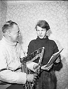 "Garech Browne and Leo Rowsome.29/02/1959..The Hon. Garech Domnagh Browne, born 25 June, 1939, is a member of the titled family of Oranmore and Browne in the West of Ireland and is a wealthy patron of Irish arts, notably traditional Irish music. He is often known by the gaelic designation of his name, Garech de Brún, or alternately Garech a Brún especially in Ireland...He is the eldest of the three sons of Dominick Browne, the 4th Lord Oranmore and Browne and his second wife, Oonagh Guinness, daughter of Hon. Arthur Ernest Guinness who was the second son of the first Lord Iveagh. Oonagh was therefore a wealthy heiress to the Guinness fortune and the youngest of the three ""Golden Guinness Girls"". His father had the rare distinction of sitting silently in the House of Lords for 72 years until his death at age 100 in August 2002, without ever having spoken in debate. ...HI brother Tara Browne Browne (04/03/1945 – 18/12/1966) was a young London socialite. He was killed in a car accident in London and is said to have served as an inspiration for the Beatles song ""A Day in the Life""....Garech Browne has been a leading proponent for the revival and preservation of traditional Irish music, through his record label Claddagh Records which he founded with others in 1959. His former house, Woodtown Manor, near Dublin was for many years a welcoming place for Irish poets, writers and musicians and which was associated with the folk-pop group Clannad, where they made many recordings of their music. When in Ireland, he lives at Luggala set deep in the Wicklow Mountains. The house has been variously described as a castle or hunting lodge of large proportions which he inherited from his mother. It has a fairytale setting and is famous for its hospitality and house parties since the time of his mother's residency. ..He is instantly recognisable by his famous pony-tail, wispy beard, tweed suit and dapper appearance...He was married at Bombay in 1981 to the Princess Harshad Purna D"