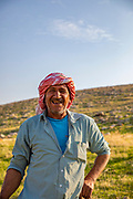 Portrait of a Palestinian shepherd with his herd of sheep in the Jordan River Valley, The Jordan Rift Valley, also Jordan Valley also called the Syro-African Depression, is an elongated depression located in modern-day Israel, Jordan, and Palestine. This geographic region includes the entire length of the Jordan River – from its sources, through the Hula Valley, the Korazim block, the Sea of Galilee, the (Lower) Jordan Valley, all the way to the Dead Sea,
