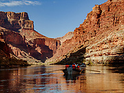 """Rafting through Marble Canyon on day 2 of 16 days boating 226 miles down the Colorado River in Grand Canyon National Park, Arizona, USA. Marble Canyon runs from Lees Ferry at River Mile 0 to the confluence with the Little Colorado River at Mile 62, which marks the beginning of the Grand Canyon. Although John Wesley Powell knew that no marble was found here when he named Marble Canyon, he thought the polished limestone looked like marble. In his words, """"The limestone of the canyon is often polished, and makes a beautiful marble. Sometimes the rocks are of many colors – white, gray, pink, and purple, with saffron tints."""""""