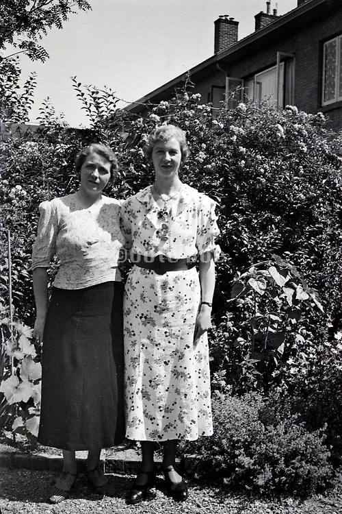 two women posing in the backyard 1950s Netherlands