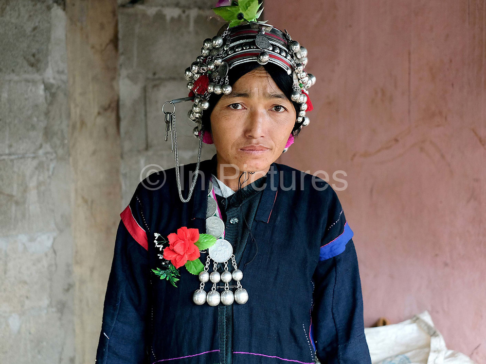 An Akha woman dressed in traditional clothing made from handspun indigo dyed cotton at a wedding in Ban Lang Pa village, Luang Namtha province, Lao PDR. One of the most ethnically diverse countries in Southeast Asia, Laos has 49 officially recognised ethnic groups although there are many more self-identified and sub groups. These groups are distinguished by their own customs, beliefs and rituals.